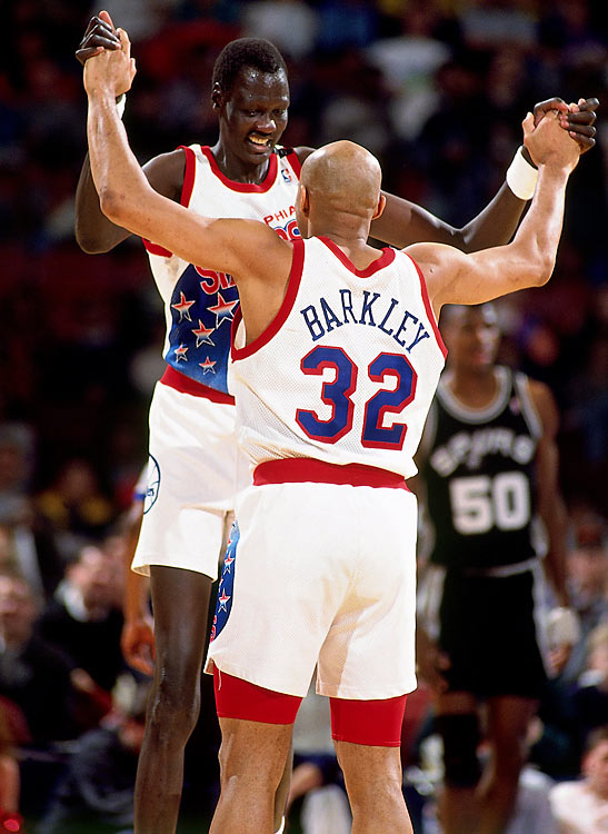 """In Philadelphia, Bol fast became friends with Charles Barkley. """"You know, a lot of people feel sorry for him, because he's so tall and awkward,"""" Barkley said of Bol in a 1990 SI feature. """"But I'll tell you this -- if everyone in the world was a Manute Bol, it's a world I'd want to live in. He's smart. He reads The New York Times. He knows what's going on in a lot of subjects. He's not one of these just-basketball guys. Basketball's just one percent of it. You know what he was talking about the other day? Milk. He was saying that he grew up on milk straight from the cow. Squeezed it himself. Milk. He says, 'Charlie, what's this lo-fat milk, this two percent milk, all of this other milk? Cows don't give lo-fat milk, two percent milk. We shouldn't drink it.' I don't know. Maybe he's got something."""""""