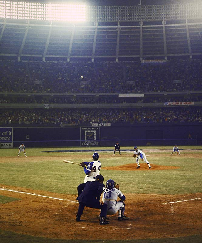 """<p><em>The top sports moments to happen within the city itself, including neutral-site matchups such as college bowl games, super bowls, NCAA Tournaments, etc.</em></p><p>After tying Babe Ruth's career home run record just days earlier in Cincinnati, Hank Aaron returned to Atlanta, where he blasted his record-setting home run in front of the home crowd. On April 8, 1974, Aaron sent a pitch off Los Angeles' Al Downing into the home bullpen at Atlanta-Fulton County Stadium, nicknamed """"The Launching Pad."""" More than 53,000 fans were in attendance as Aaron circled the bases as baseball's new home run king.</p>"""