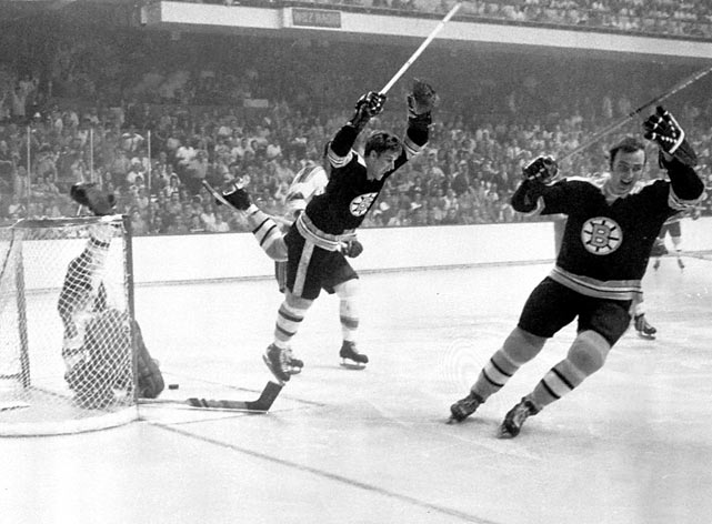 With the Bruins holding a hammerlock 3-0 series lead over the Blues in the 1970 Stanley Cup Finals, St. Louis fought Boston to a 3-3 tie in regulation of Game 4 at The Garden, forcing overtime. Just 40 seconds into the extra period, Boston's Bobby Orr scored one of the most iconic goals in hockey history. Not only did his goal win the game and the Cup for the Bruins, but also the image of Orr flying through the air with arms raised is arguably the most famous on-ice freeze frame moment of all-time. Orr's goal has been immortalized in statues, paintings and more.