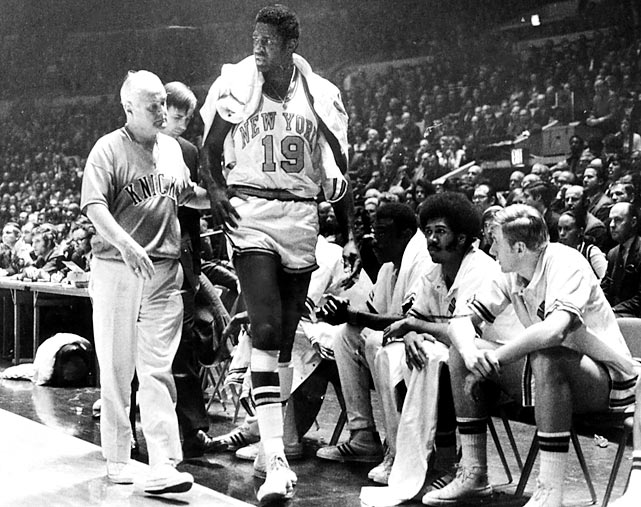 In Game 6 of the 1970 NBA Finals, Knicks center Willis Reed sat on the bench, nursing a torn right thigh muscle, while Lakers star big man Wilt Chamberlain scored 45 points and grabbed 27 rebounds, sending the series to a Game 7 in New York. Fans and players alike assumed Reed wouldn't play in the series finale, until the captain came limping out of the locker room just moments before tipoff. Reed played through the pain, scoring just four points but providing enough of an emotional spark to lead the Knicks to the franchise's first NBA title.