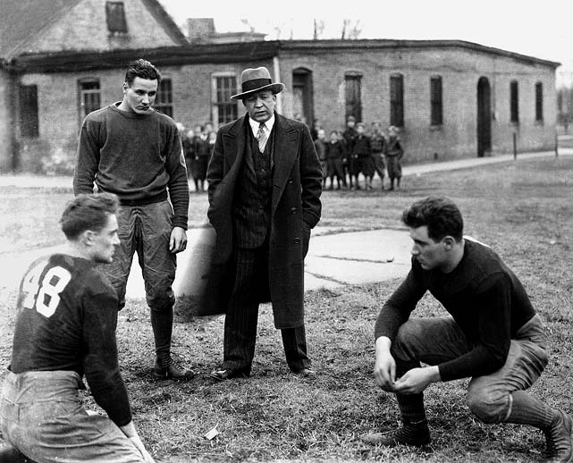 """His biography at the College Football Hall of Fame calls him """"American football's most-renowned coach"""" -- and for good reason. During his 13-year tenure, Rockne lifted Notre Dame to national prominence, compiling an amazing 105-12-5 record (an astounding 88.1 winning percentage) and five national championships. Rockne won the last 19 games he coached before dying in a plane crash in 1931."""