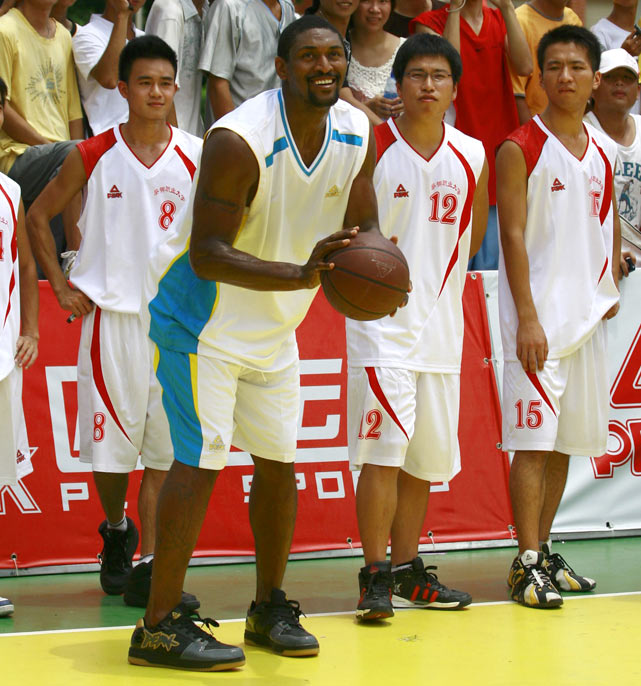 Artest  shows off his jump shot to a group of young Chinese hoopsters at a basketball clinic in Quanzhou, Fujian Province of China.