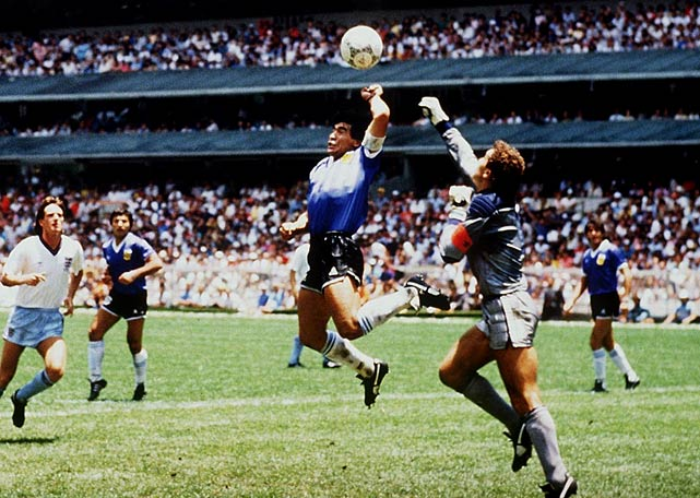 "Maradona scores with his hand against England.  The controversial ""Hand of God."""