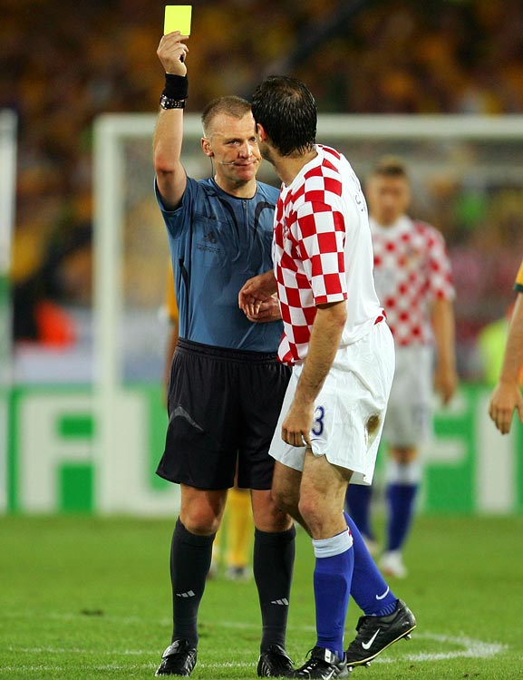 English ref Graham Poll erred by giving the same player, Croatia's Josip Simunic, three yellow cards without realizing it.