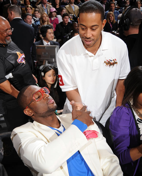"Wade greets rapper Christopher ""Ludacris"" Bridges during NBA All-Star Saturday Night in Phoenix."