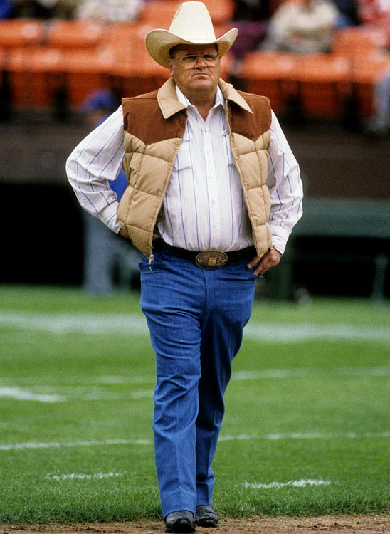 Bum Phillips, father of current Cowboys head coach Wade Phillips, pacing the field at Candlestick Park before a game against the 49ers in his trademark cowboy hat.