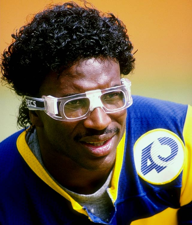 Eric Dickerson rushed for the wonderfully symmetrical 1,234 yards in 1985, seen here wearing the uber-fashionable Rec-Specs during a 13-10 win over the Vikings.