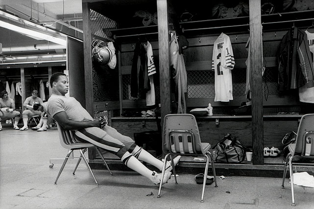 Ronnie Lott taking a moment of peace before helping the 49ers hand the Los Angeles Rams their first loss of the season. Lott had an interception in the game.