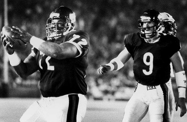 "William ""The Refrigerator"" Perry, a defensive tackle by trade, was used as a goal line fullback during the 1985 Super Bowl run by the Chicago Bears. Here Perry celebrates after scoring a touchdown against the Packers at Soldier Field."