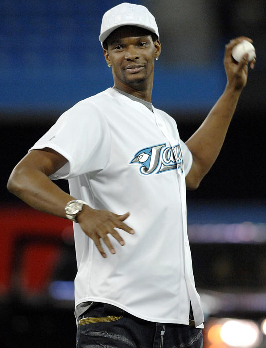Bosh throws the ceremonial first pitch before the Blue Jays game against the  Royals.