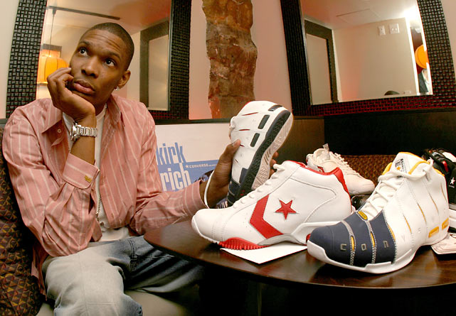 Bosh checks out footwear at the Converse NBA All-Star press conference in Denver.