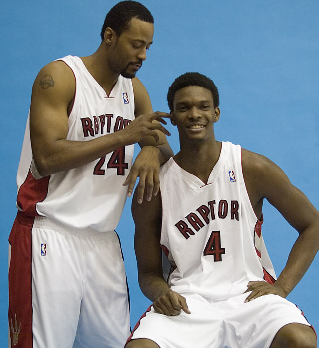 Morris Peterson jokes around with Bosh during team photos in Toronto.