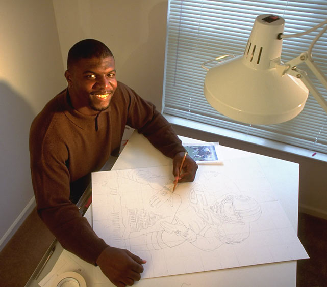 <p>Redskins linebacker Terry Crews, who is currently starring in<em> The Expendables</em>, shows off his art work.</p>
