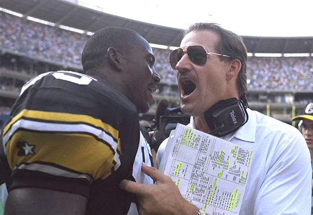 Steelers coach Bill Cowher congratulates linebacker Greg Lloyd after Pittsburgh's 31-15 victory over the Chargers.