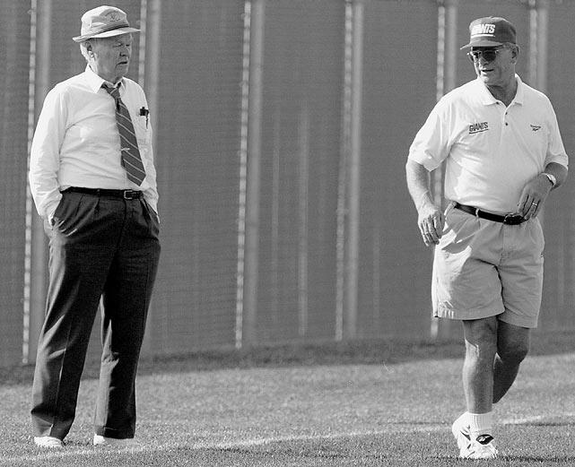 Giants owner Wellington Mara and Dan Reeves watch practice.
