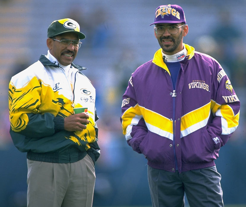 Green Bay offensive coordinator Sherman Lewis talks with Minnesota defensive coordinator Tony Dungy before the Vikings-Packers NFC Central battle.