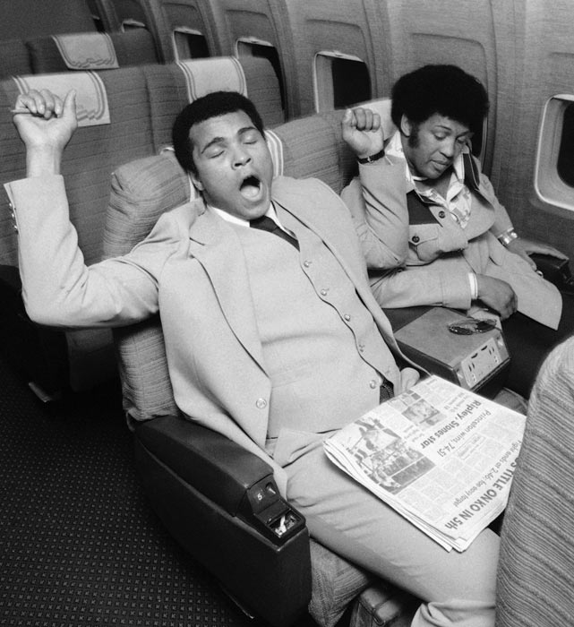 <p>Muhammad Ali gets ready for a nap on the flight back to Chicago after his victory over Jean-Pierre Coopman.</p>