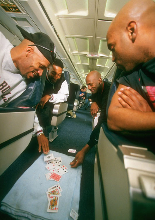 Ron Harper, Scottie Pippen and Michael Jordan playing cards on the Bulls' team plane.