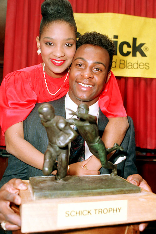 Sporting the flattop, Rice smiled with his wife after receiving the NFL MVP award in January 1988.