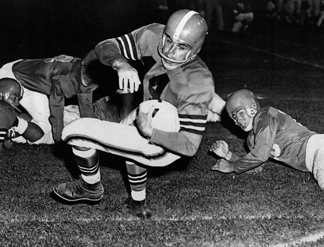 <p>Paul Brown's perfect quarterback: Under Graham the Browns played in 10 straight titles games and won four AAFC and three NFL Championships. He wore No. 14 from 1952 to 1956, leading the league in passing in '52 and '53.</p><p><strong></strong>Runner-up: Y.A. Tittle</p><p>Worthy of consideration: Ken Anderson, Steve Grogan, Don Hutson, Ed Podolak</p>
