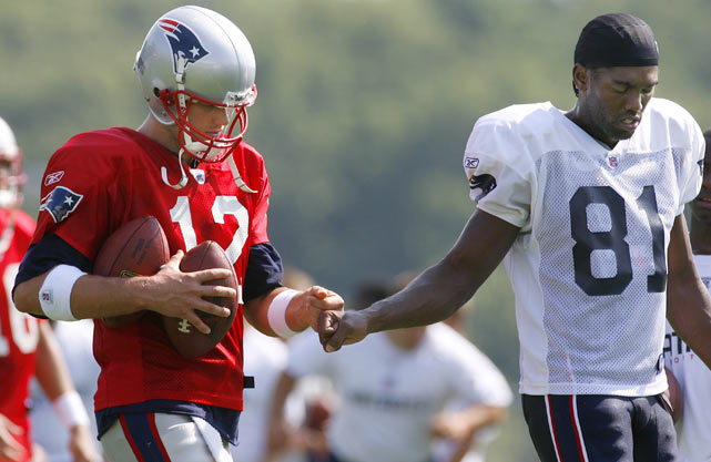 Patriots quarterback Tom Brady and wide receiver Randy Moss get in sync during a training camp practice in Foxboro, Mass.