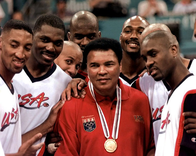 Muhammad Ali poses with members of the 1996 Dream Team after the hoop stars received the gold medal in Atlanta.