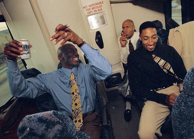 Michael Jordan, Ron Harper and Scottie Pippen celebrate on the team bus after winning the NBA title.