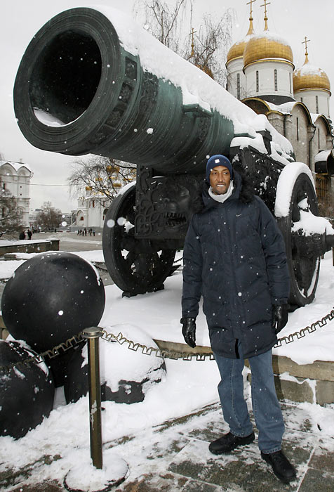 Pippen poses in front of the Czar Cannon, with the Assumption Cathedral in the background, during a sightseeing tour of the Kremlin in Moscow.