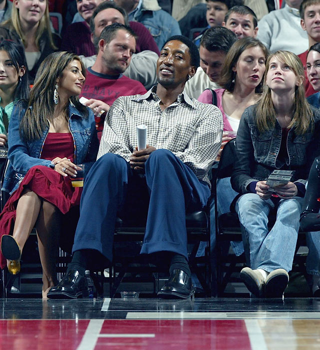 Pippen enjoys the action from courtside as the Bulls and Bucks square off in a preseason game.