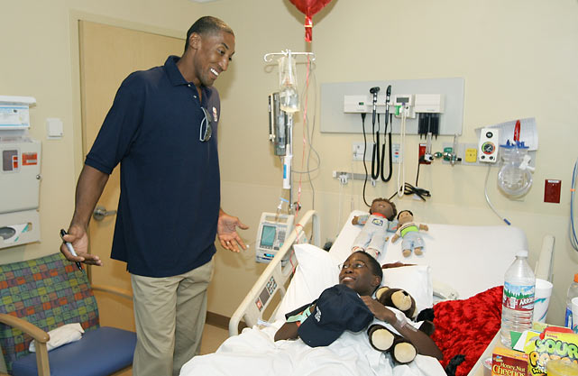Pippen visits a child at Sunrise Children's Hospital during All-Star Weekend in Las Vegas.