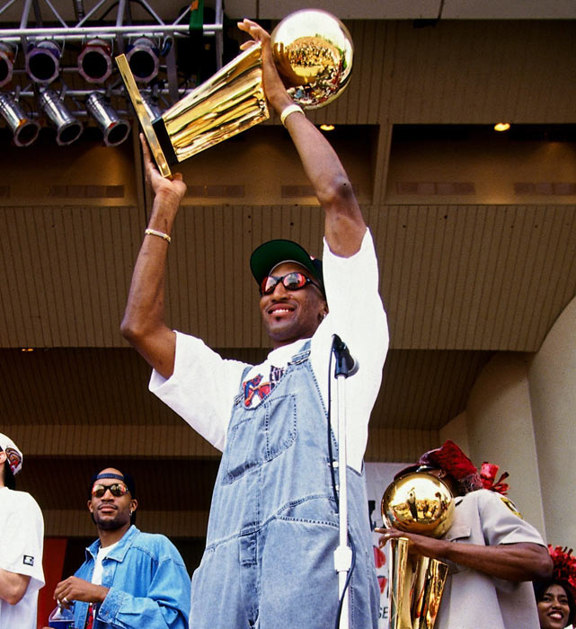 Pippen celebrates with the Larry O'Brien trophy at the Bulls' championship parade in Chicago