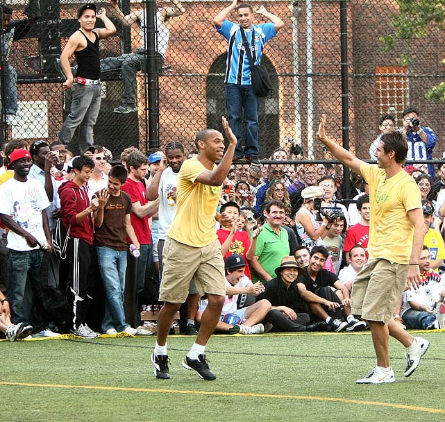 Nash celebrates with Thierry Henry during the Showdown in Chinatown celebrity soccer match in New York City in 2008.  A multi-sport talent, Nash also put his soccer skills on display during the 2005 Slam Dunk contest, heading a pass to Amare Stoudemire to spark a spectacular jam.