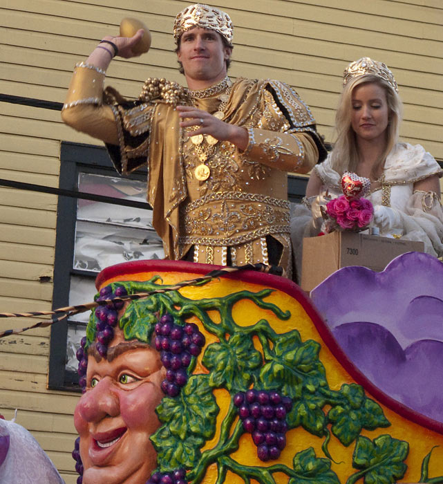Brees and wife Brittany glide down the New Orleans streets in style during the team's Super Bowl parade on Feb. 14, tossing beads, footballs and doubloons at adoring fans.  After his performance in the playoffs, Brees had the Saints faithful treating him like royalty.