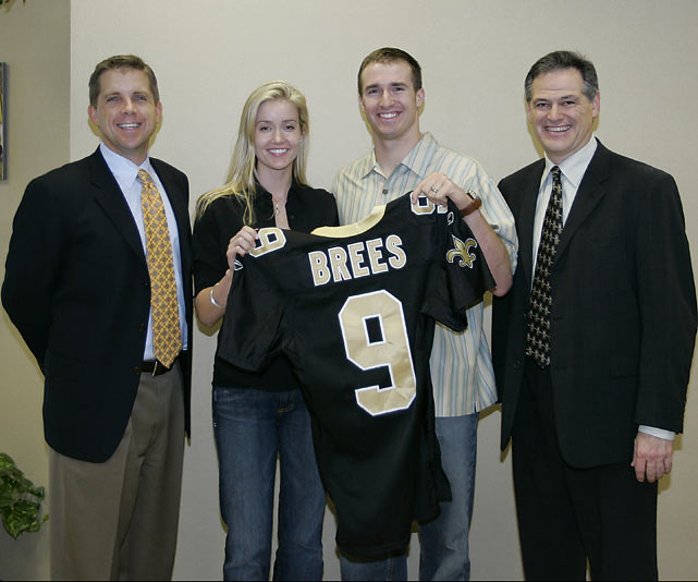 Brees poses with coach Sean Payton, wife Brittany and general manager Mickey Loomis after signing a six-year, $60 million deal with the Saints in 2006.  Number nine would prove to be a wise investment for New Orleans, leading the franchise to its only Super Bowl championship.