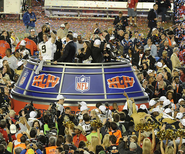 Amid the falling confetti, Brees hoists the Lombardi Trophy after New Orleans 31-17 Super Bowl victory over the Colts.  Brees was terrific -- completing 32-of-39 attempts for 288 yards and two touchdowns -- and was named Super Bowl MVP.