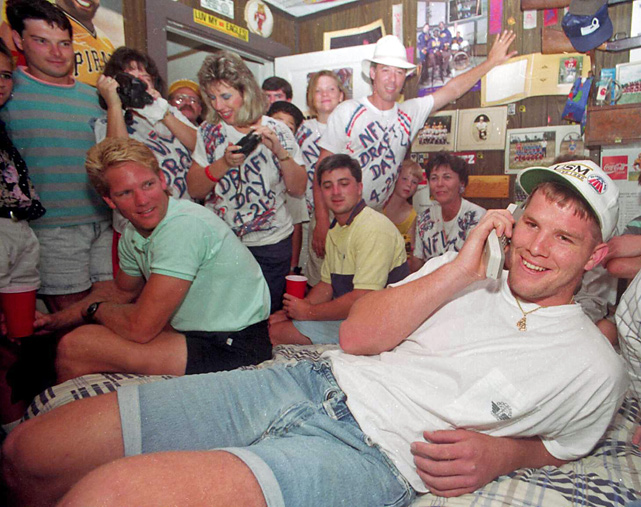 Favre takes a call from the Falcons while surrounded by friends and family in his bedroom. Atlanta drafted Favre in the second round but traded him to Green Bay the following season. The rest is history: Favre started 297 straight games, won three MVPs and led the Packers to the 1997 Super Bowl title. He'll be eligible for the Hall of Fame in 2016.