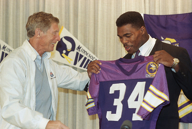 Coach Jerry Burns smiles as his new running back holds up his Vikings jersey. But it cost a king's ransom to acquire the 1982 Heisman trophy winner from the Cowboys. Dallas received five players and seven draft choices, which helped set the table for the team's success in the 1990s. Among the players drafted with those picks: Emmitt Smith, Darren Woodson and Russell Maryland.