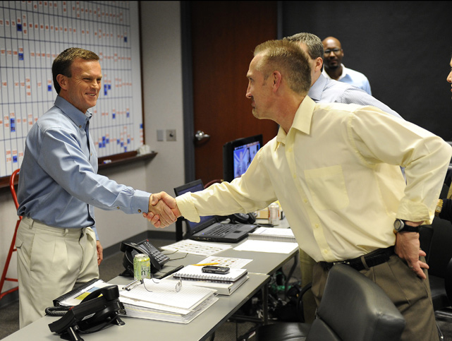 General manager Billy Devaney shakes hands with head coach Steve Spagnuolo after the Rams selected Sam Bradford with the first overall pick of the 2010 NFL Draft.