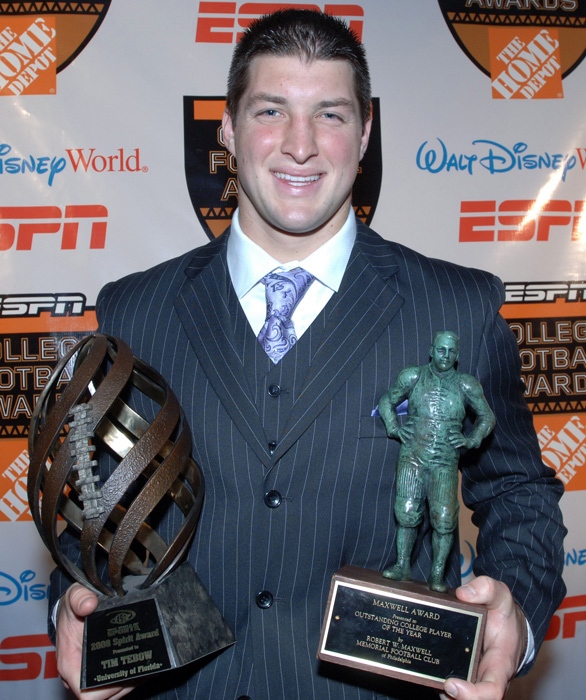 Tebow holds the Disney Spirit Award (left) and the Maxwell Award, given to the nation's best all-around player. Tebow finished 2008 with 2,746 passing yards 42 total touchdowns.