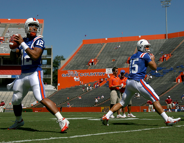 Tebow (right) and Chris Leak warm up before a Florida home game against Alabama in 2006. The quarterbacks would split time during Tebow's freshman year and go on to win a BCS national title.