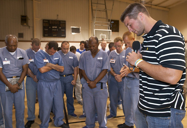 Tebow prays with inmates at Lawtey Correctional Institution. Tebow and former NFL head coach Tony Dungy often share their faith in America's prisons.