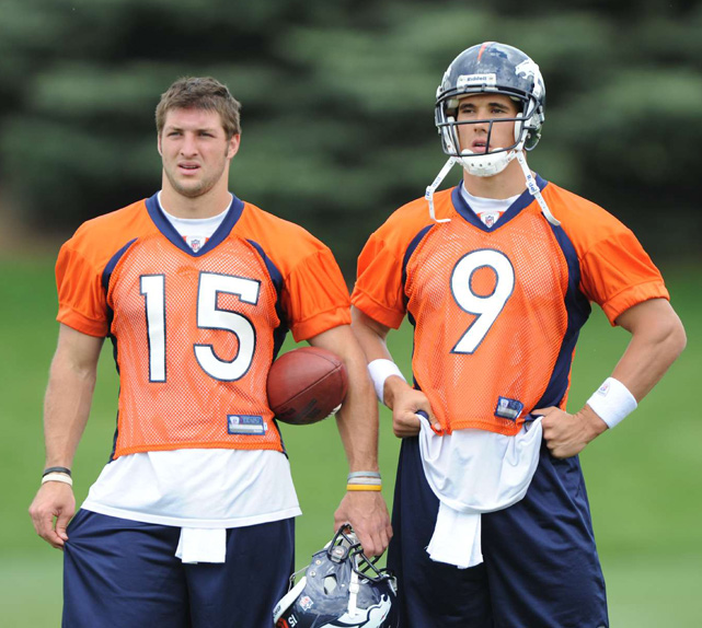 Tebow and Brady Quinn look on during a 2010 minicamp workout in Denver. They started the 2010 and 2011 regular seasons as Kyle Orton's backups.