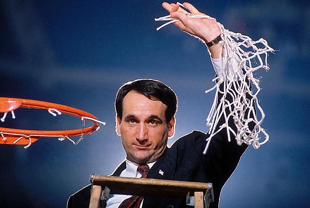 Krzyzewski holds the net after winning the NCAA Midwest Regional Final in 1991. He would go on to win his first NCAA championship that season. He has led Duke to 11 Final Fours.