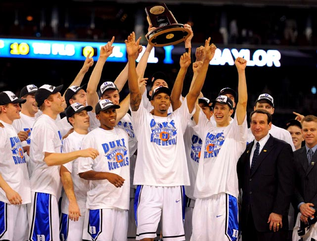 Krzyzewski celebrates with his team after winning his fourth NCAA championship. Duke defeated Butler 61-59 to win the national title.