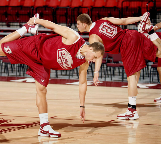 Teammates Blake and Taylor get loose before an Oklahoma practice.