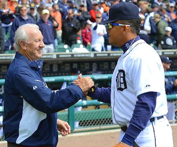 Former Tigers great Al Kaline (left), who threw out the first pitch at Comerica Park, shakes hands with Miguel Cabrera.