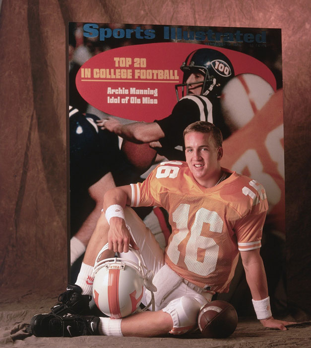 Peyton Manning strikes a relaxed pose during a 1996 photo shoot. A printout of his dad Archie's 1970 SI cover is in the background.