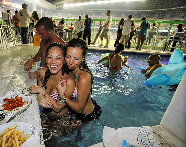Fans can watch the game and dine from a swimming pool behind left field.