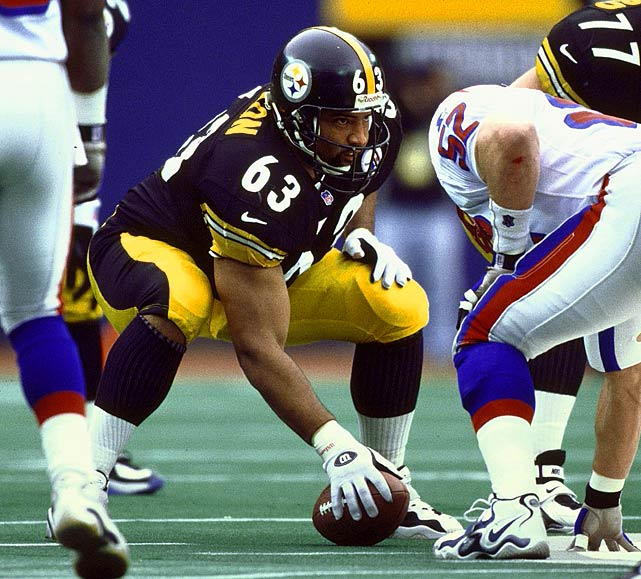 """A seven-time Pro Bowler and six-time first-team All-Pro center, Dermontti Dawson replaced a future Hall-of-Famer only to become one himself. Drafted in the second round out of Kentucky in the 1988 NFL Draft, Dawson assumed Mike Webster's starting center position in 1989. No other player would start at center for the Steelers until 1999. Renowned for his leverage and quickness, Dawson earned the nicknamed """"Dirt"""" because of his abilities to pile-drive opposing defensive linemen into the ground. Dawson was named co-AFC Offensive Lineman of the Year in 1993 and NFL Offensive Lineman of the Year in 1996. Former Steelers coach Bill Cowher claimed Dawson """"redefined the center position"""" while Bill Belichick, who coached Cleveland in the early 1990s, lauded his """"exceptional quickness."""" His 170 consecutive games played ranks second in club history. Dawson was named the first-team center on the NFL 1990s All-Decade Team in 2007. Dawson started in three AFC championship games and Super Bowl XXX."""
