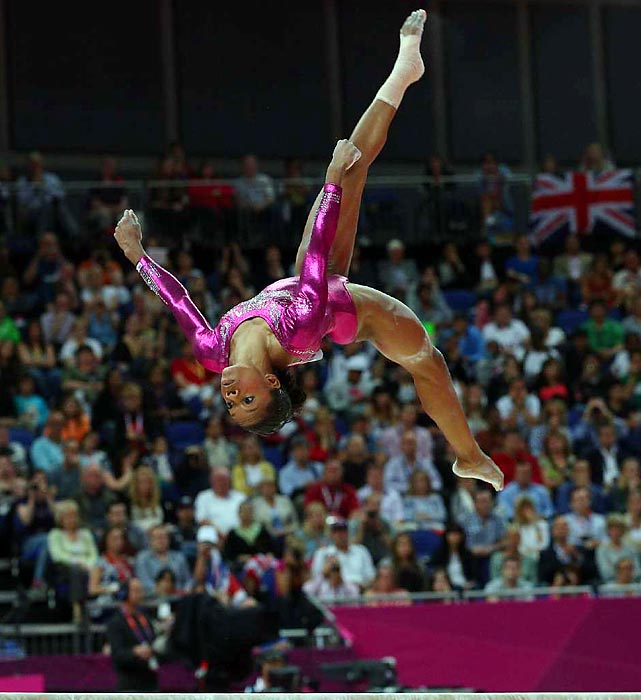 Douglas, shown here mid-flip during day six of the London Games, received the Olympic gold medal in individual all-around at only 16 years old.